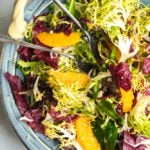 A bowl of frisse and orange salad