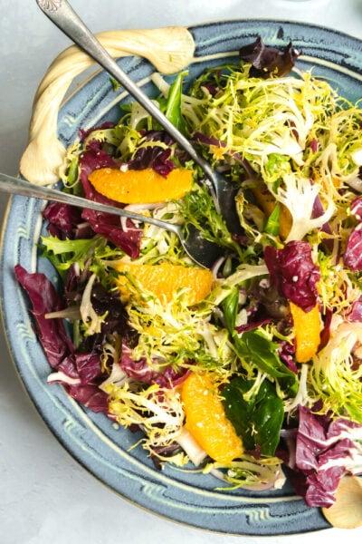 A bowl of frisse and orange salad