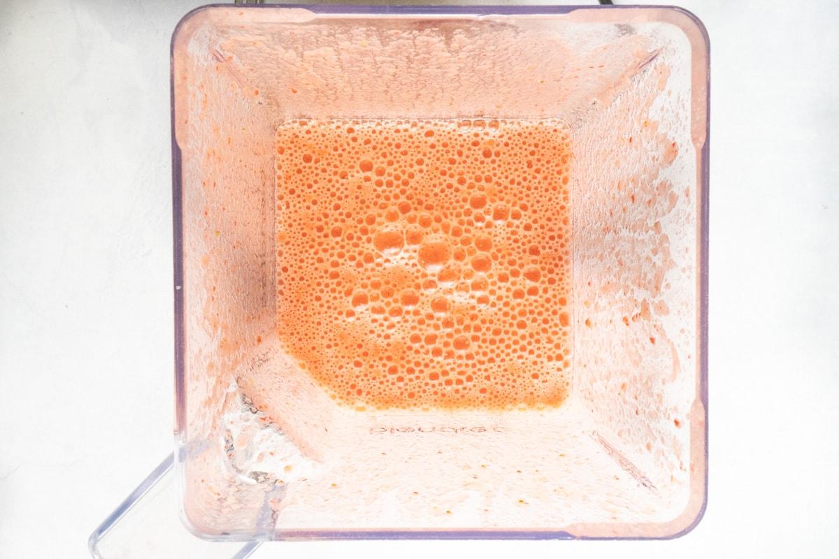 Pureed strawberries and lemon juice in a blender for homemade strawberry lemonade