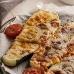 A close up of a zucchini pizza boat recipe on a platter