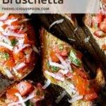 Pinterest pin showing pieces of homemade bruschetta close up