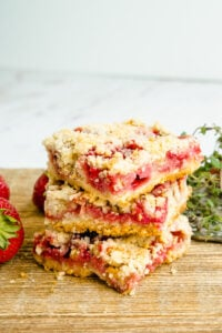 A stack of dessert squares made with strawberries.