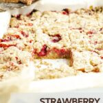 Pinterest pin showing a pan of dessert squares made with strawberry filling and one square missing.