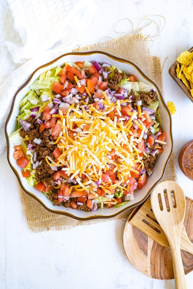 A taco salad bowl made with ground beef.