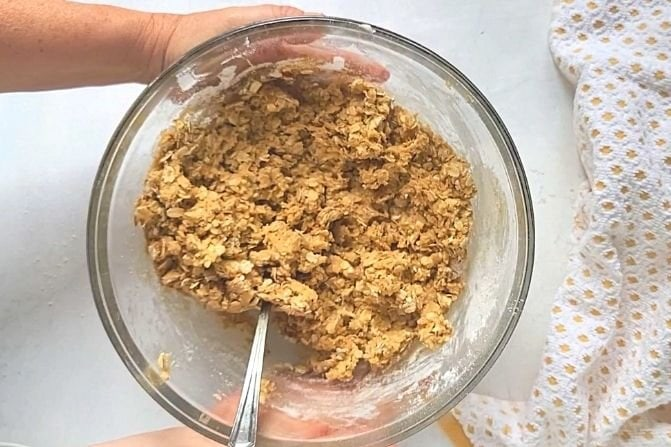 Homemade oatmeal cookie dough in a bowl.