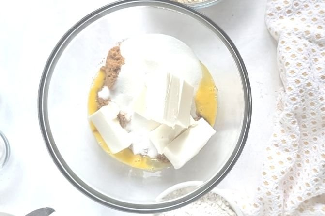 A bowl filled with shortening and sugar.