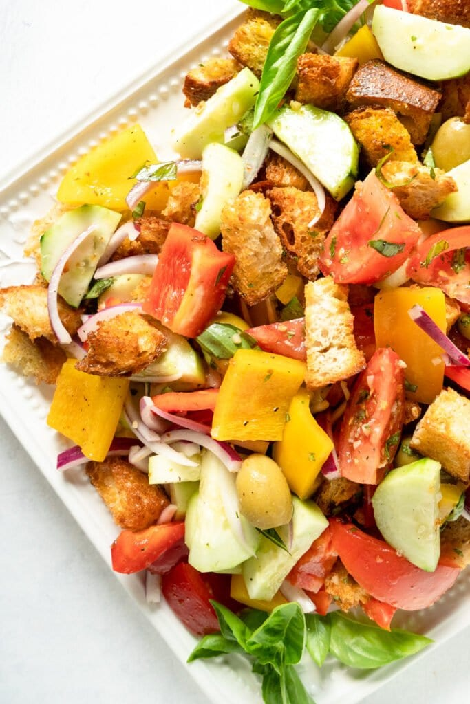 A platter filled with an Italian Panzanella Salad