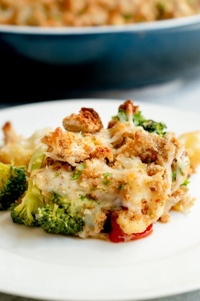 A slice of a broccoli cauliflower cheese bake