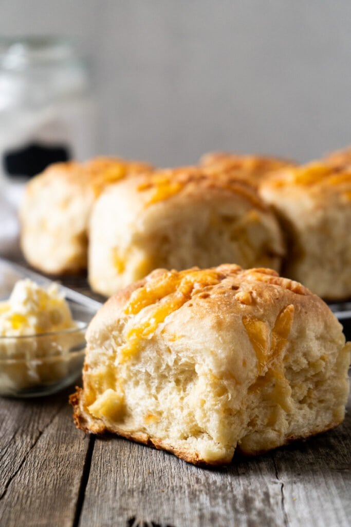 Cheese bread rolls on a table with butter.