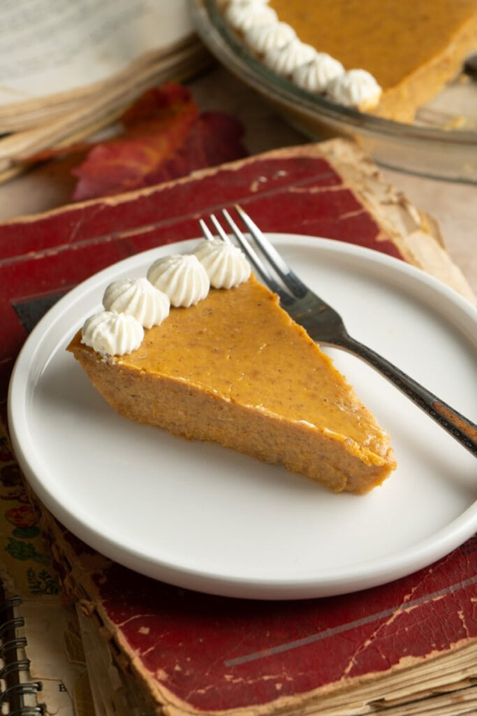 A slice of easy crustless pumpkin pie on a plate.